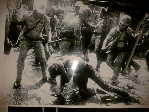 "THIS PHOTO of police brutality on protesters is among those displayed in the exhibit, ""Himagsik at Protesta,"" put up by Karapatan at the University of the Philippines Library until Sept. 21 for the 40th anniversary of the declaration of martial rule. PHOTO REPRODUCTION BY TONETTE OREJAS"