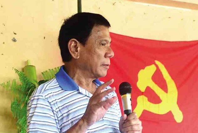 DUTERTE during turnover ceremonies for police officers taken captive by the NPA            CONTRIBUTED PHOTO