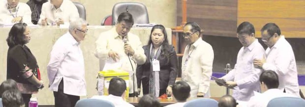 CONGRESS CONVENES      Senate President Franklin Drilon (second from left) and House Speaker Feliciano Belmonte Jr. turn over the contents of one ballot box to Sen. Koko Pimentel and Rep. Boyet Gonzales  at the Batasang Pambansa complex. LYN RILLON